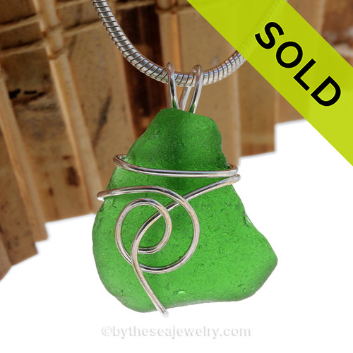 This natural sea glass piece is Vivid Green Genuine Sea Glass In Sterling Sea Swirl Setting Pendant for Necklace. SOLD - Sorry This Sea Glass Pendant is NO LONGER AVAILABLE!