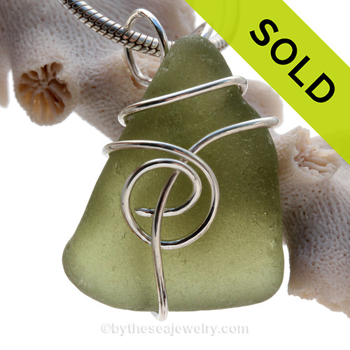 This natural sea glass piece is Seaweed Green Genuine Sea Glass In Sterling Sea Swirl Setting Pendant for Necklace.
