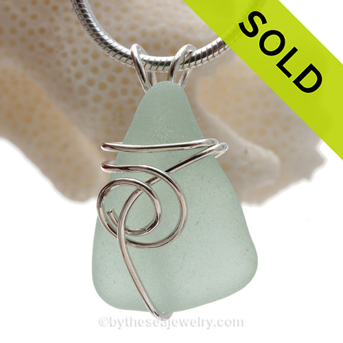 This natural sea glass piece is Pure Fresh Seafoam Green Genuine Sea Glass In Sterling Sea Swirl Setting Pendant for Necklace.