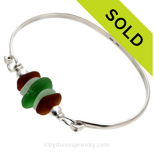 5 Pieces of Genuine Sea Glass in stunning Greens and Amber on this Solid Sterling Half Round Bangle Bracelet With Dolphin Beads. SOLD - Sorry this Sea Glass Bangle Bracelet is NO LONGER AVAILABLE!