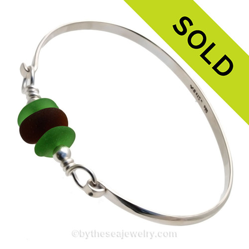 3 Pieces of Genuine Sea Glass in stunning Greens and Amber on this Solid Sterling Half Round Bangle Bracelet With Sterling Silver Beads.
