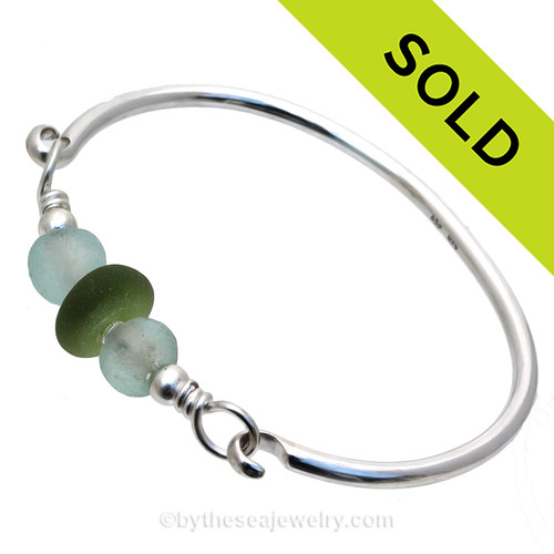 Perfect Seaweed Green English Sea Glass combined with two Seawater Green Recycled Glass Beads on this Solid Sterling Silver Premium Sea Glass Bangle Bracelet.