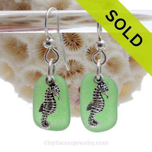 A perfect matched pair of beautiful  green Sea Glass Earrings combined with solid sterling sea horse Charms and a setting that leaves much of the beauty of these sea glass pieces shine.