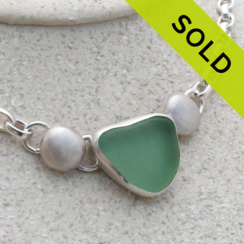 A stunning vibrant yellowy seafoam sea glass set in fine silver with sterling details on a oval rolo chain. SOLD - Sorry this Sea Glass Jewelry selection is NO LONGER AVAILABLE!