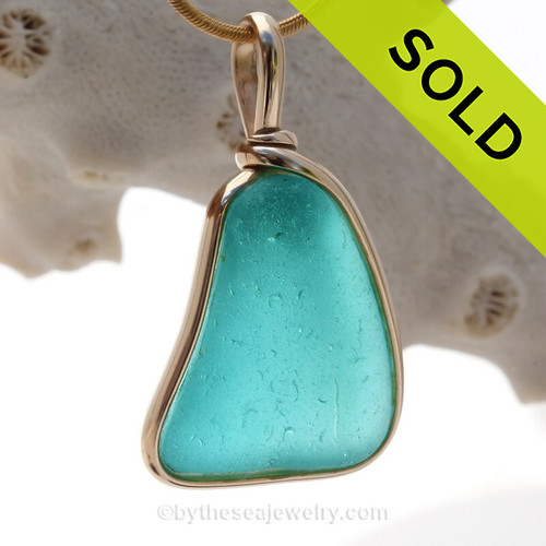This is a beautiful Deep Vivid Aqua Blue Genuine Sea Glass set in our Original Wire Bezel© pendant setting in 14K Goldfilled