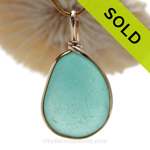 This is a beautiful LARGE Deep Vivid Aqua Blue Genuine Sea Glass set in our Original Wire Bezel© pendant setting in 14K Goldfilled.