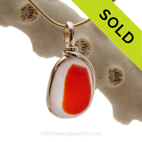 A stunning piece of flashed vivid orange Genuine Sea Glass set in our Original Wire bezel© setting in 14K Rolled Gold.