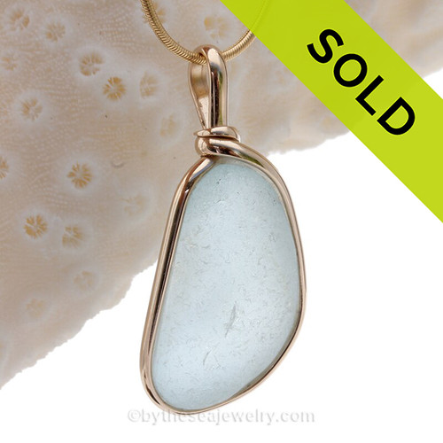 This is a LARGE and THICK Baby Blue Genuine Sea Glass set in our Original Wire Bezel© pendant setting in 14K Rolled Gold.