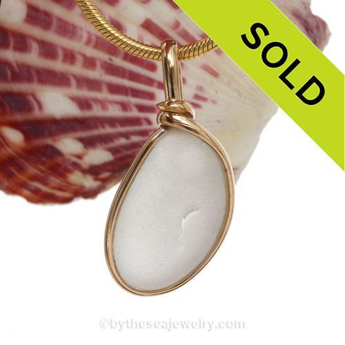 A cool shape of Genuine Sea Glass set in our Original Wire Bezel© setting in 14K Rolled Gold