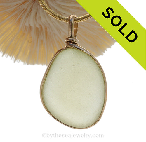 A lovely thick naturally aged pure Pale Butter Yellow natural sea glass piece set in our Original Wire Bezel setting in 14K Rolled Gold setting.