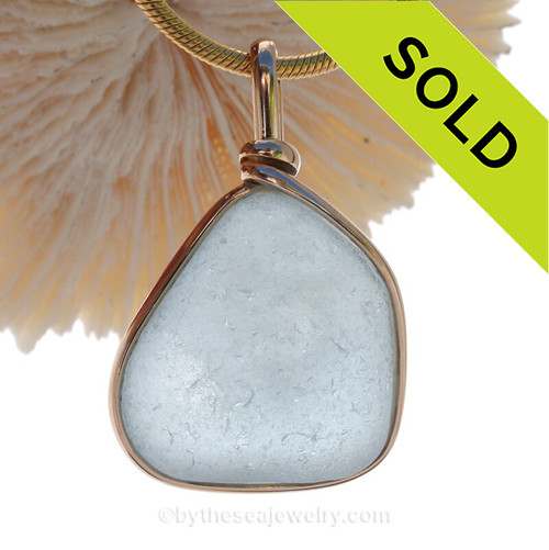 This is a LARGER flat Carolina Blue Genuine Sea Glass set in our Original Wire Bezel© pendant setting in 14K Rolled Gold.