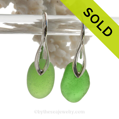 A fresh and clean natural beach found Sea Glass Earrings in THICK Vivid Green on Sterling Silver Deco Hooks. Simple and elegant with genuine sea glass pieces.