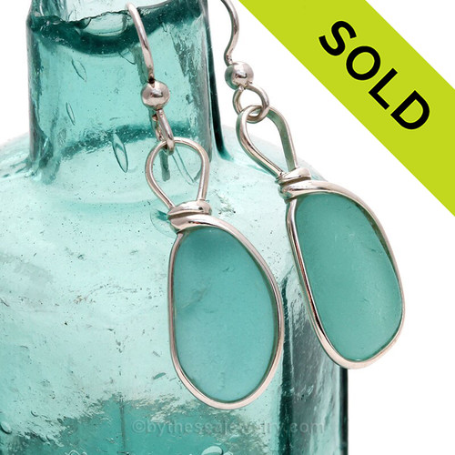 Round and Thick pieces of natural Vivid Aqua Green sea glass set in our Original Wire Bezel© earring setting. Unaltered genuine sea glass from Seaham England and the site of former glass factories that discarded glass into local waters.