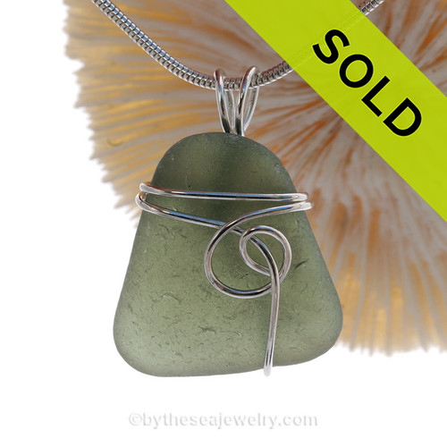 This natural sea glass piece is natural Seaweed Sea Green Genuine Sea Glass In Sterling Sea Swirl Setting Pendant for Necklace.