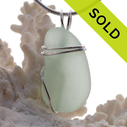 A beautiful perfect piece of genuine Sea Glass Pendant in soft Sea Green in a simple secure wire wrapped sterling setting.