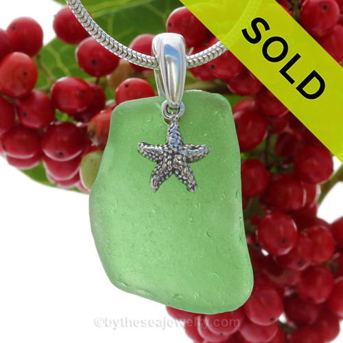 A nice piece of Green Natural Sea Glass Necklace Set On Silver Bail/.