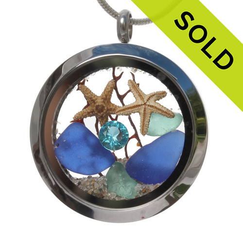Beautiful dark blue and aqua sea glass combined in a stainless steel locket necklace a two real starfish and beach sand. A seafan makes this a great choice for any ocean lover!  SOLD - Sorry This Sea Glass Jewelry Item is NO LONGER AVAILABLE!