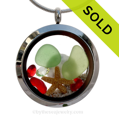Green and Rare Ruby Red sea glass and a real starfish and baby sandollar finished with real beach sand make this a great locket necklace for the holidays. Swarovksi Crystal gems bring in a bit of holiday bling! SOLD - Sorry This Sea Glass Jewelry Item is NO LONGER AVAILABLE