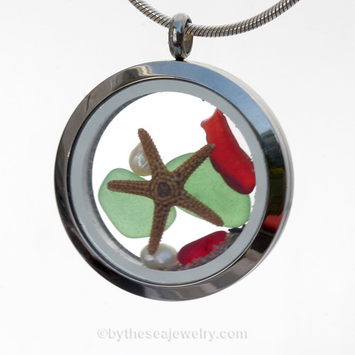 Green and Rare Ruby Red sea glass and a real starfish and Genuine Pearls finished with real beach sand make this a great locket necklace for the holidays. Available - This is the EXACT Sea Glass Jewelry piece you will receive!
