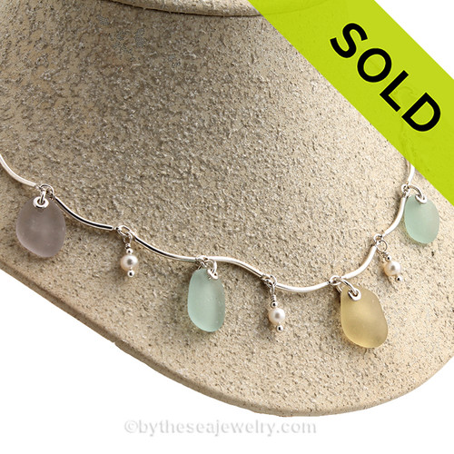 Pastel Passion -Gold, Aqua and Lavender Genuine Sea Glass from in a Solid Sterling Silver Curved Bar Necklace with Cultured AAA Pearls 5 Piece of beach found Genuine Sea Glass from our friend and collector in New England dangle among pearls on this elegant and feminine necklace. All Solid Sterling Silver Components.