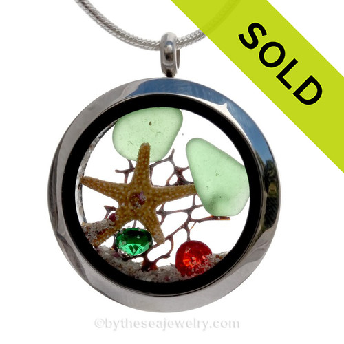 Green sea glass and a real starfish and Bling Crystal gems in green and red finished with real beach sand make this a great locket necklace for the holidays.