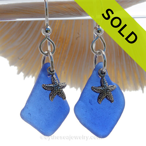 A nicely matched pair of LARGE Cobalt Blue Sea Glass Earrings combined with Solid Sterling Starfish Charms and a setting that leaves much of the beauty of these sea glass pieces shine.