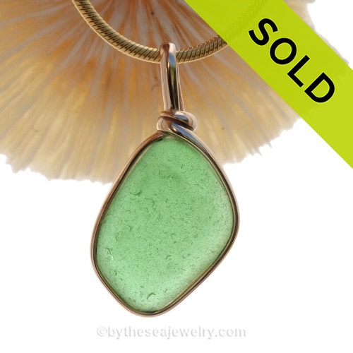 A thinner piece of green Genuine Sea Glass set in our Original Wire Bezel© setting in 14K Rolled Gold. SOLD - Sorry this Sea Glass Jewelry selection is NO LONGER AVAILABLE!