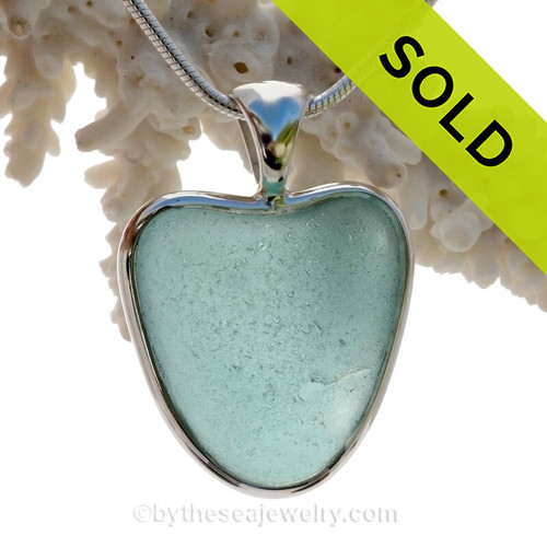 A beautiful stunning Aqua Blue natural Sea Glass Heart Pendant set in our Deluxe Wire Bezel© setting in Solid Sterling Silver.