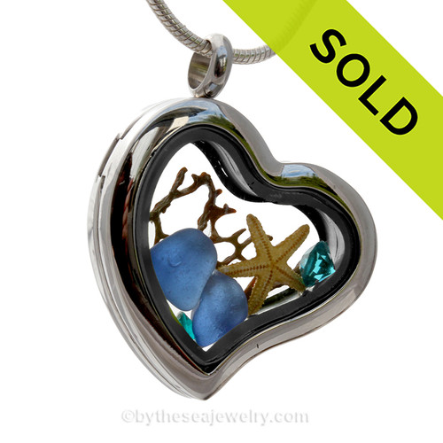 Beautiful pieces cobalt blue and aqua sea glass pieces combined with a real starfish and a premium Turquoise Gems in this Genuine Sea Glass Heart Locket Necklace.
