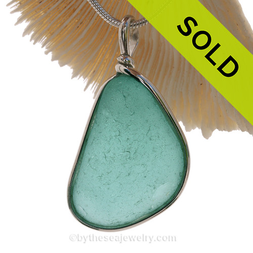 This is a LARGE and PERFECT Aqua Blue Green Genuine Sea Glass set in our Original Wire Bezel© pendant setting in Sterling Silver .