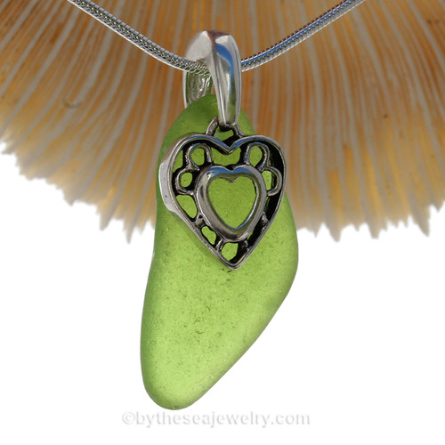 Stunning glowing Vivid Lime Green genuine sea glass with a solid sterling bail and detailed heart in hearts charm. This is the EXACT Sea Glass Necklace that you will receive!