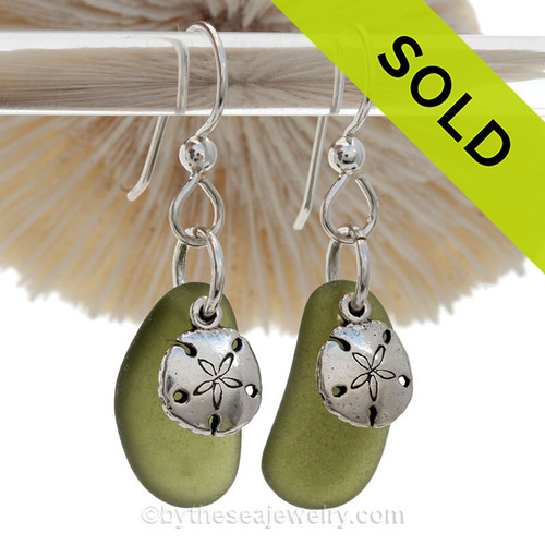 A simple pair of green Genuine Sea Glass Earrings with sterling beachy Sandollar charms in a lightweight simple setting.