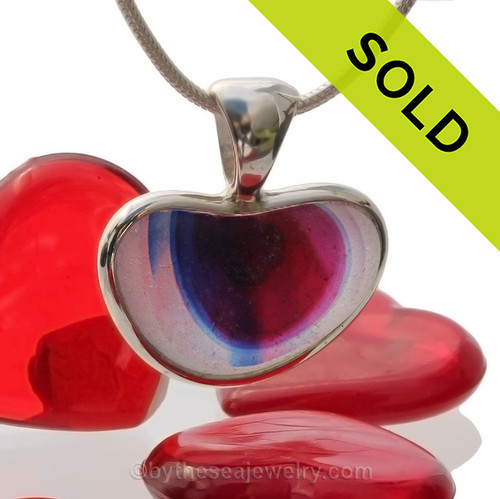 A  natural beach found mixed blue  and hot pink sea glass heart set in our Deluxe Wire Bezel© A great necklace for any time of year and perfect for any sea glass lover!