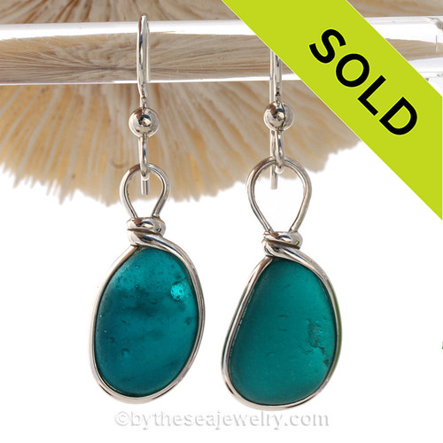 A P-E-R-F-E-C-T match in  Sea Glass Earrings in a vivid Vivid Deep Turquoise or Teal set in our Original Wire Bezel© setting in silver.