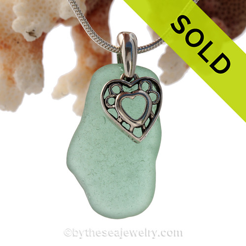 Stunning glowing Tropical Long Aqua Green genuine sea glass with a solid sterling bail and detailed heart in hearts charm.