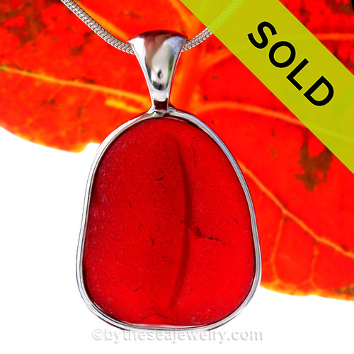 This Huge and Thick and P-E-R-F-E-C-T Embossed Vivid Cherry Red Genuine Sea Glass set in Solid Sterling Silver Deluxe Wire Bezel setting. This setting leaves this amazing natural sea glass piece just the way it was found on  the beach!  This setting leaves this amazing natural sea glass piece just the way it was found on  the beach!