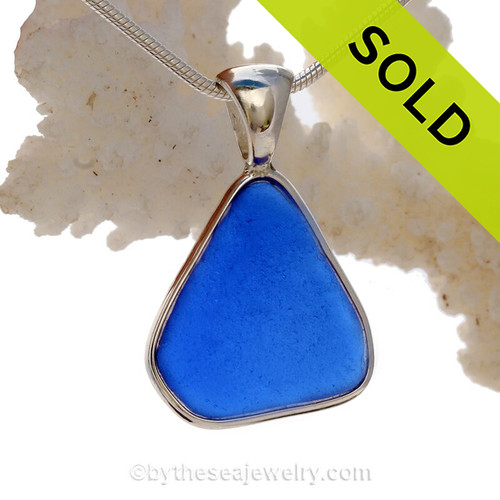 A lovely triangle of Cobalt Blue Sea Glass In a Solid Sterling Silver Wire Bezel© Necklace Pendant. A lovely piece of lucky blue sea glass in a classic setting of sterling silver.