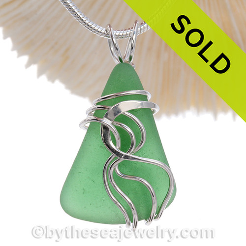 Green Genuine Sea Glass Sterling Waves© Signature Sterling Setting Pendant. This perfect natural beach found sea glass in our WAVES sterling necklace pendant setting that maximizes the bling of silver yet leaves most of the sea glass open and UNALTERED from the way it was collected on the beach.