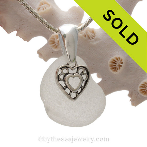Thick White Genuine sea glass with a solid sterling bail and detailed heart in hearts charm.