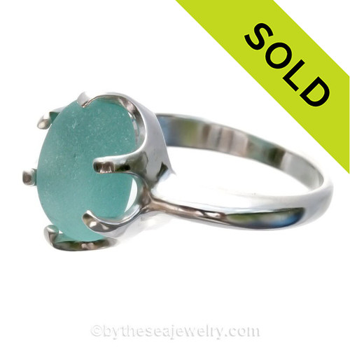 A stunning piece of Victorian Era Aqua sea glass set in a secure solid sterling prong ring.
