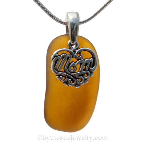 A beautiful and PERFECT beach found vivid amber brown sea glass necklace set on a solid sterling cast bail with a sterling silver mom charm