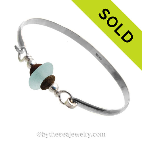 Soft Aqua Blue Genuine English Sea Glass & Natural Beach Stones on this Solid Sterling Silver Half Round Sea Glass Bangle Bracelet. This is finished in solid sterling beads. SOLD - Sorry this Sea Glass Jewelry selection is NO LONGER AVAILABLE!