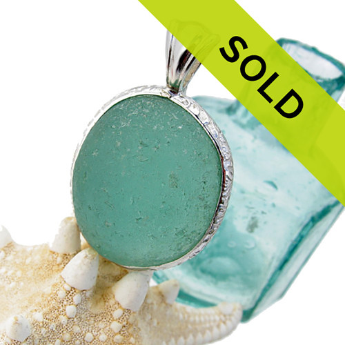 This STUNNING HUGE aqua sea glass piece is from England. It is set in a sterling pattern wire with a cast silver bail. Great and will accommodate ANY necklace you may already own. SORRY, THIS SEA GLASS PENDANT HAS BEEN SOLD!