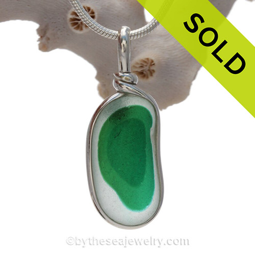 stunning piece - This photo does not do it justice. Very 3 dimensional colors that are fused inside this 150 year old sea glass piece found in Seaham England. of vivid teal green sea glass set for a necklace in our Original Sea Glass Bezel© in solid sterling silver setting.
