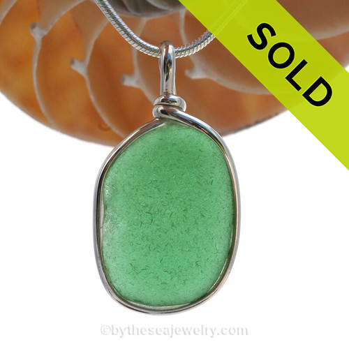 A Classic Green beach found sea glass set in our signature Original Wire Bezel© pendant setting in Solid Sterling Silver.