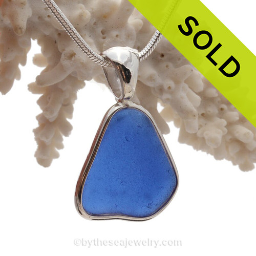 Bright Blue Sea Glass In a Solid Sterling Silver Wire Bezel© Necklace Pendant. A great piece if you are fond of wearing denim.