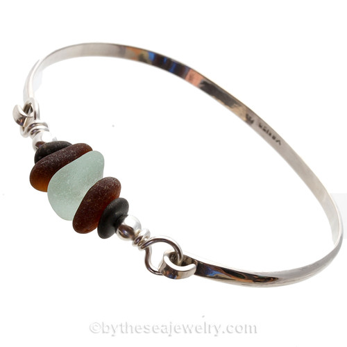 A thick piece of very round piece of sea green English Seaham Sea Glass combined with Amber brown and two natural beach stones for a lovely Fall Look.