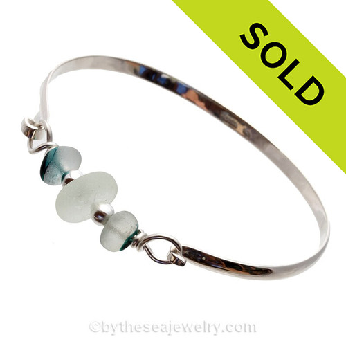 A Stunning Aqua and English Multi Sea Glass combined with real cultured pearls on this Solid Sterling Silver Half Round Sea Glass Bangle Bracelet.
