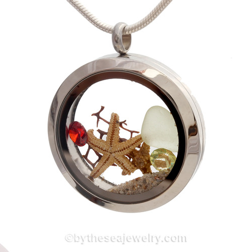 Pale Green sea glass and Garnet Red and Peridot green gemstones make this a great locket necklace for the holidays.