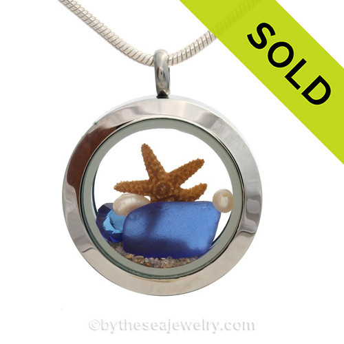A BEAUTIFUL Natural Cobalt Blue a Sapphire Crystal Gem in this Sea Glass Mini Locket Necklace with a real starfish and real freshwater Pearls. SOLD - Sorry this Sea Glass Jewelry selection is NO LONGER AVAILABLE!
